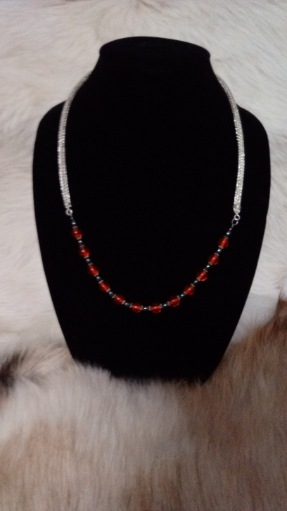 One of our favorites blending sterling Viking Weave with scarlet lampwork glass and hematite- a real show stopper!